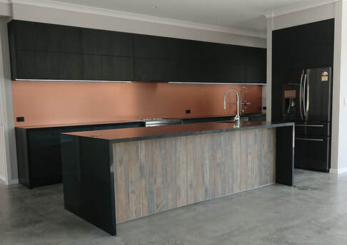 Industrial Kitchen, LED light, Cooper splashback kitchen, Black kitchen, Kitchen island, Concrete floor, Flap doors